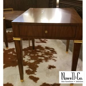 wood and gold accent side table with rug